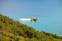 Firefighting plane in the air. Firefighting plane training in Krka park, Croatia royalty free stock photos