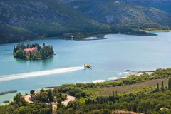 Firefighting plane in the air. Firefighting plane training near the island and monastery Vysovas, Krka park in Croatia stock image