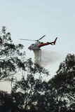 Firefighting tanker helicopter Stock Images