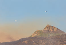 Firefighting Using Helicopters in the Mountains Royalty Free Stock Image