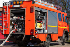 Firefighting vehicle with hose. German Firefighting vehicle with hose royalty free stock photo