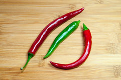 Fireflame Hot Peppers on Wood Stock Images
