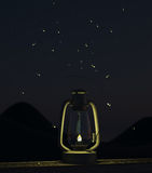 Fireflies fly around the oil lamp Stock Photography