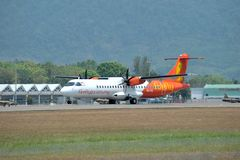 Firefly aircraft ATR 72-600. LANGKAWI, MALAYSIA - MARCH 17: Firefly aircraft ATR 72-600, Registration name 9M-FIE, take-off at Langkawi airport on 17 March, 2015 stock photography