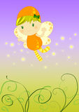 Firefly fairy. Cute orange firefly fairy flying on a garden above grass leaving a stray of magic shiny stars Stock Photo