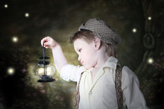 Firefly Fun. Child holding latern will fireflies stock images