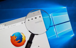 Firefox web browser. MONTREAL, CANADA - JUNE 4, 2016 : Firefox web browser under magnifying glass. Firefox is a free and open-source web browser developed by the Stock Photography
