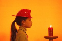 Firegirl. Girl , playing in fireman game Royalty Free Stock Photography