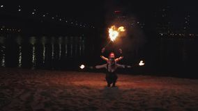 Firegirls doing movements holding burning torches stock video footage