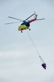 Fireguard helicopter MI-8 with water tank Royalty Free Stock Photo