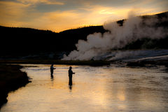 Firehole Fishing. Anglers fishing just after sunset on Yellowstone's Firehole River royalty free stock images