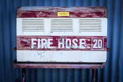 Firehose at harbour Sydney. A vintage firehose in the harbour of sydney Stock Image