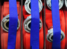 Firehose linedup in a fire department Royalty Free Stock Photography