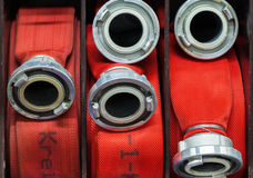 Firehose rolled up in a fire department Royalty Free Stock Image