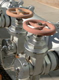 Firehose Valves. Close-up of silver firehose valves on exterior of building Stock Photos