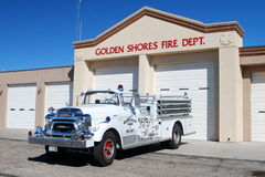 FIREHOUSE AND FIRE ENGINE. Golden Shores Arizona firehouse and antique fire engine Stock Photography