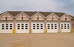 Firehouse garages. Row of garage doors for a firehouse Royalty Free Stock Images