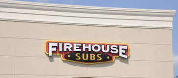 Firehouse Subs Sign. Firehouse serves a variety of hot gourmet sub sandwiches. Made with premium meats and cheeses, steamed hot and piled high on a toasted sub Royalty Free Stock Photography