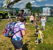 Fireman's Ladder Truck Spraying Water on Children - 2. Salem, VA – July 28th: Fireman's ladder truck spraying water as children play under stock image