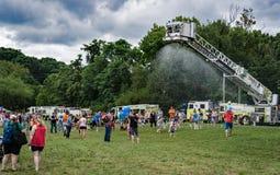 Fireman's Ladder Truck Spraying Water Stock Photos