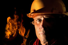 Fireman. Portrait of a fireman isolated in black Royalty Free Stock Image