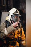 Fireman. In fire protection suit and mask Royalty Free Stock Photo