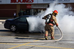 Fireman. In Oakville, Ontario, Canada Putting out a car fire Stock Photos