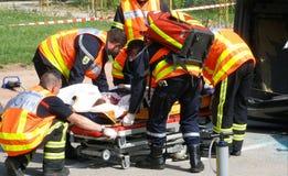 Fireman. Saving driver car accident Royalty Free Stock Photos