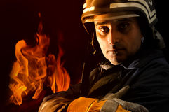 Fireman. Portrait of a fireman with fire isolated in black Stock Photo