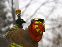 Fireman. Fighting Fire Stock Photo