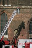 Fireman. In front of burning church Stock Images