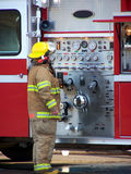 Fireman. Adjusting controls Stock Image