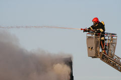 Fireman in action Royalty Free Stock Image