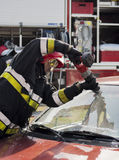 Fireman in action at car accident Royalty Free Stock Photos