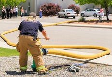 Fireman in Action Royalty Free Stock Images