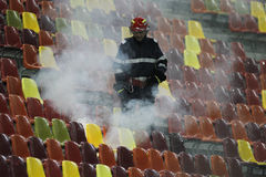Fireman in action. Middle aged fireman in action during football game on National Arena, Bucharest Royalty Free Stock Photography