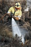 Fireman in action stock images