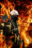 Fireman. With an axe, in the middle of flames Royalty Free Stock Images