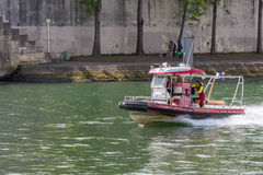 Firefighters boat on river Seine Stock Photography