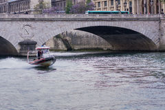 Firefighters boat on river Seine Royalty Free Stock Image