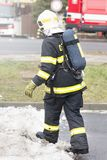 Fireman with breathing apparatus going into an action. Real fire scene. Czech Republic.  stock images