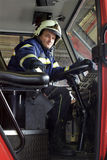 Fireman in cabin Royalty Free Stock Photography