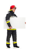 Fireman carrying blank placard. Stock Image