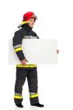 Fireman carrying blank placard. Stock Image