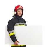 Fireman carrying blank placard. Royalty Free Stock Image