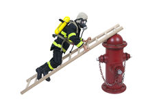 Fireman Climbing Ladder on Hydrant Stock Photo