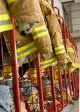 Fireman Coats 2. A line of fireman coats await the next call stock images