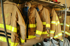 Fireman coats. Some Firemans coats hanging in a firehouse