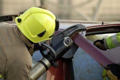 Fireman cutting boot Stock Photography