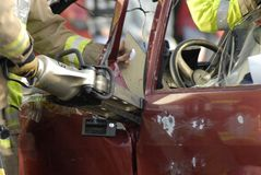 Fireman cutting car Stock Photography